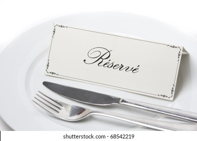 Generic reserved sign on a white plate with fork and knife