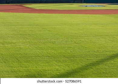 Generic scene of infield dirt and outfield grass on baseball field