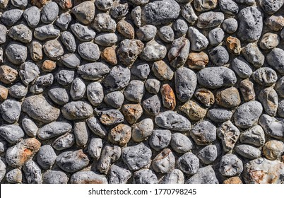 Generic seamless old cobbled stone wall background texture.