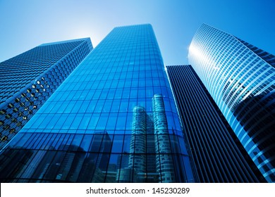 Generic unidentified business skyscrapers, sunny blue sky.