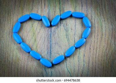 Generic viagra blue pills on white and black background