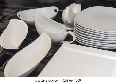 Generic white dinnerware set with assorted plates, jugs and gravy boats ready to serve food
