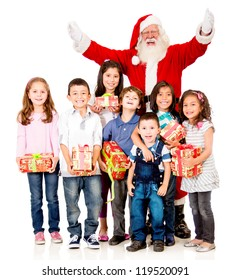 Generous Santa Claus with a group of children holding presents - isolated