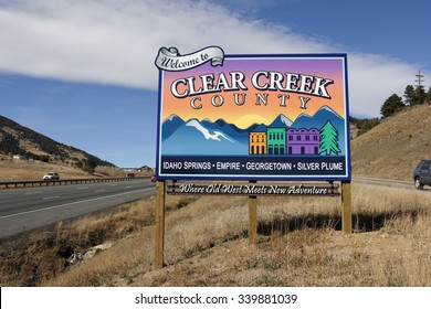 Genesee, CO, USA - November 8, 2014: Westbound on I-70 towards Idaho Springs, Empire, Georgetown, Silver Plume and more towns, Where Old West Meets New Adventure, sign.
