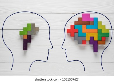 Genetic Brain disorder. Health and illness. Mental health and mental disorder concept. Heads with shapes of abstract brain. Two human heads silhouette with small and big brain.