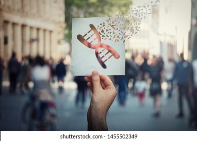 Genetic manipulation and DNA modification concept as human hand holding a paper with gene editing symbol broken into pieces over a crowded street background. Biotechnology engineering and medicine.