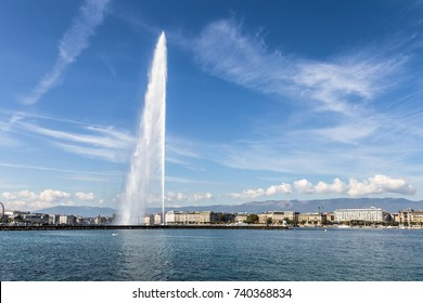 Geneva cityscape with its famous Jet d'Eau (fountain) on Geneva lake on a sunny summer day in Switzerland