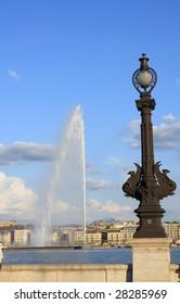 Geneva lake in sunny day, water jet in Geneva lake