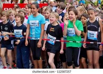 GENEVA - MAY 5: Unidentified athletes competing in the childrens race of the 2012 Geneva Marathon for UNICEF, May 5, 2012 in Geneva, Switzerland.