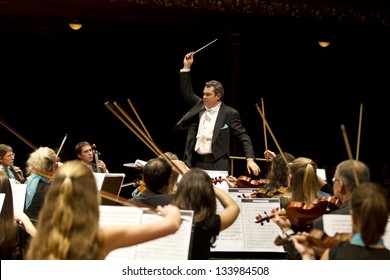 GENEVA - NOVEMBER 17: Conductor Antoine Marguier conducts the United Nations Orchestra at the Victoria Hall November 17, 2012 in Geneva, Switzerland.