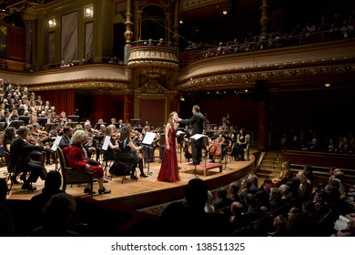 GENEVA - NOVEMBER 17: Conductor Antoine Marguier conducts the United Nations Orchestra and Soprano Alexandra Hewson at the Victoria Hall November 17, 2012 in Geneva, Switzerland.