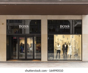 GENEVA, NOVEMBER 17: A HUGO BOSS outlet, November 17, 2013, Geneva, Switzerland. Based in Metzingen in Germany it has 12,000 staff, 840 own stores and 2012 sales of EUR 2.3 billion in 129 countries.