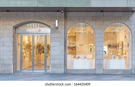 GENEVA - NOVEMBER 3: A Swatch store November 3, 2013, Geneva, Switzerland. Swatch Group employs more than 29,700 staff in over 50 countries with gross sales in 2012 of 8 billion Swiss francs.