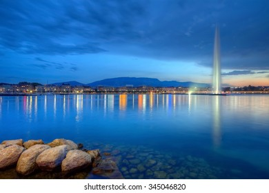 Geneva panorama with famous fountain by night, Switzerland, HDR