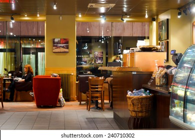 GENEVA - SEP 15: Starbucks cafe interior on September 15, 2014 in Geneva, Switzerland. Starbucks is the largest coffeehouse company in the world, with more then 23000 stores