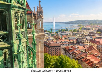 Geneva skyline, Leman Lake, Jet d'eau fountain, bay, harbor and Tower of Cathedral, French Swiss in Switzerland. View of Romanesque bell tower and spire of Saint-Pierre Cathedral. Sunny day blue sky.