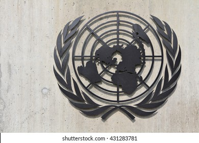 GENEVA, SWITZERLAND, 13 MARCH 2016: The emblem of the United Nations (UN), an intergovernmental organization to promote international co-operation, on the wall of the UN Headquarters in Geneva.