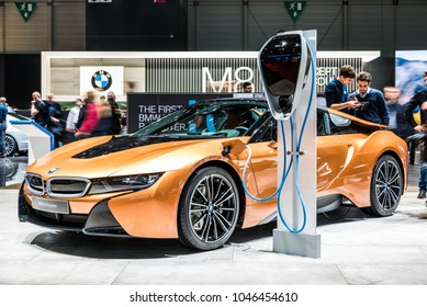 Geneva, Switzerland 13. March 2018 Front side view of BMW i8 Roadster Plug-in hybrid next to the charging station at 88th Geneva International Motor Show.