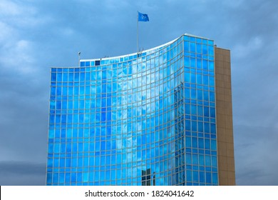 Geneva, Switzerland - Aug 16, 2020: the building of the World Intellectual Property Organization, WIPO. A specialized agency of the United Nations located in Geneva. UN flag on the top of skyscraper.