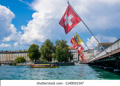 Geneva / Switzerland - Aug 2015: Mont Blanc bridge and Swiss flags over Geneva Lake.