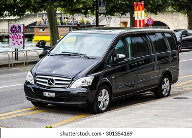 GENEVA, SWITZERLAND - AUGUST 4, 2014: Black luxury van Mercedes-Benz W639 Vito at the city street.
