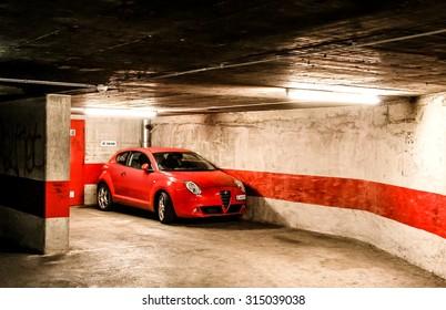 GENEVA, SWITZERLAND - AUGUST 4, 2014: Motor car Alfa Romeo MiTo at the underground parking.