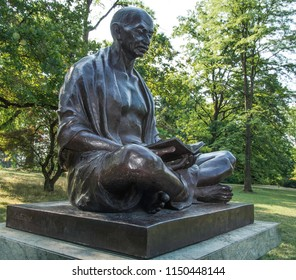 "Geneva, Switzerland - August 6, 2018: Monument to Indian politician Mahatma Gandhi in Aryan Park near the UN complex in Geneva. Quote on the monument: ""My life is my message."""