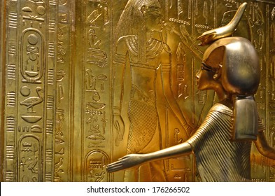 GENEVA, SWITZERLAND - DECEMBER 17: Ancient egyptian gold statue of the protecting goddess Serket at the Tutankhamun exhibition :  December 17, 2013 in Geneva Switzerland