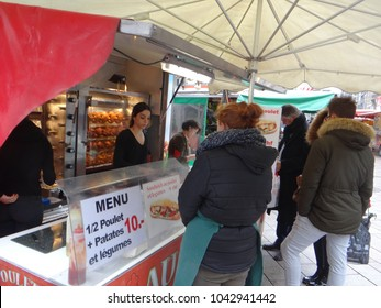 GENEVA, SWITZERLAND - FEB 24, 2018 - Selling rotisserrie chickens at a weekly market in Geneva, Switzerland