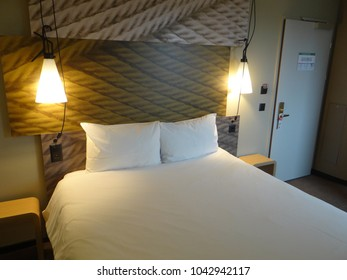 GENEVA, SWITZERLAND - FEB 24, 2018 - Bed in modern hotel room in Geneva, Switzerland