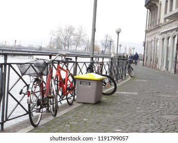 GENEVA, SWITZERLAND - FEB 24, 2018 - Bicycles parked along the river bank in Geneva, Switzerland