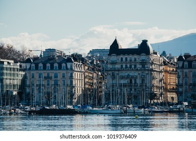 GENEVA, SWITZERLAND - February 3, 2018: Beautiful lake in Geneva with tourist and ships. The city is the capital of the Swiss canton of Geneva and the second most populous city in Switzerland.