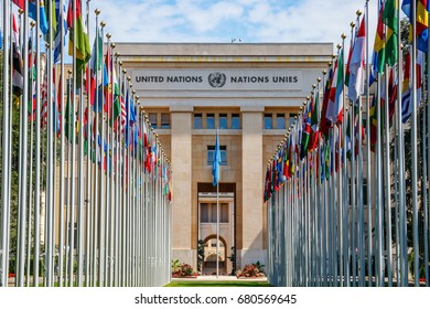 """GENEVA, SWITZERLAND - JULY 11, 2017: The """"Allee des Nations"""" (Avenue of Nations) of the Geneva United Nations Palace, with the flags of the member countries."""