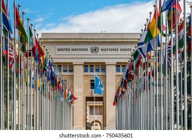 """GENEVA, SWITZERLAND - JULY 12, 2017: The """"Allee des Nations"""" (Avenue of Nations) of the Geneva United Nations Palace, with the waving flags of the member countries."""