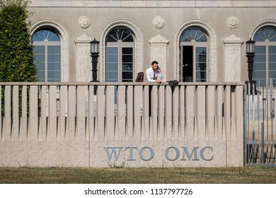 Geneva, Switzerland - July 17 2018: An unidentified man makes a telephone call at the offices of the World Trade Organization