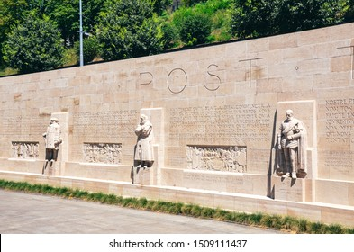 Geneva, Switzerland - July 19, 2019: The Reformation Wall, monument to the Protestant Reformation of the Church. Depicting numerous Protestant figures. Geneva was the centre of Calvinism.
