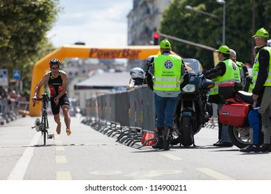 GENEVA, SWITZERLAND - JULY 24: Unidentified male cyclist completing the cycling section of the 2011 ITU International Geneva Triathlon, July 24, 2011 in Geneva, Switzerland.