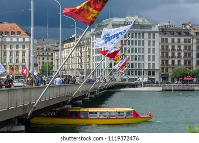 Geneva, Switzerland - june 06, 2018: All along the Mont Blanc bridge, fixed flag-bearers are lined up on both sides. If the Swiss and Geneva flags are most often alternated,