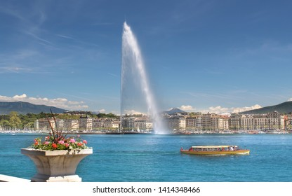 Geneva / Switzerland - June 1 2019. Lovely view of the Geneva Water Fountain, Jet d'Eau. One of the in Geneva famous yellow boats. Geneva, Switzerland.