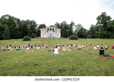Geneva, Switzerland - June 10 2018: An outdoor yoga class in session.