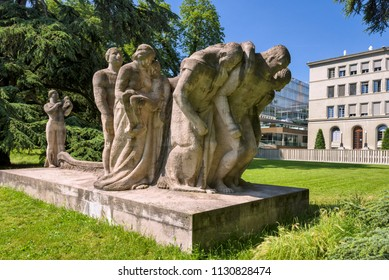 "Geneva, Switzerland - june 10, 2018 : The new building of the World Trade Organization (WTO) and in the park, the sculpture, entitled ""The Human Effort"" was made by James Vibert in 1935"