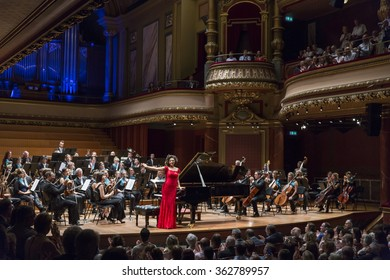 GENEVA, SWITZERLAND - JUNE 13, 2015: Pianist Khatia Buniatishvili is applauded for her performance with the UN Orchestra conducted by Antoine Marguier in aid of Syrian refugees at the Victoria Hall.