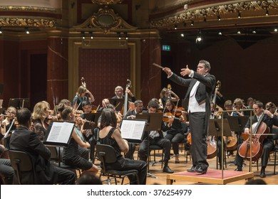 GENEVA, SWITZERLAND JUNE 13, 2015: Antoine Marguier conducts the UN Orchestra at a concert in aid of Syrian refugees at the Victoria Hall.