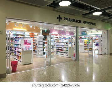 Geneva, Switzerland - June 2019: Pharmacy store display at the international airport in Geneva. This store sell medicine, cosmetics, makeup, travel supplies... Pharmacie principale sign.