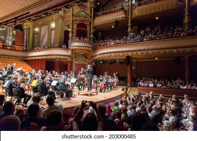 GENEVA, SWITZERLAND - JUNE 22, 2014: Antoine Marguier conducts the United Nations Orchestra at the Victoria Hall during a free concert as part of the city's festival of music.