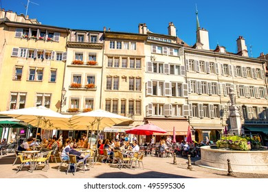 Geneva, Switzerland - June 23, 2016: Bourg-de-four square with people sit in cafes and restaurants. It is the oldest square and the most popular meeting place in Geneva