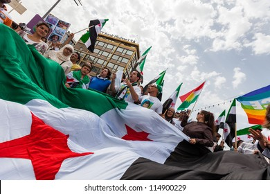 GENEVA, SWITZERLAND - JUNE 30: Unidentified protesters during a protest against President of Syria Bashar al Asaad in the center of the city of Geneva, June 30, 2012 in Geneva, Switzerland.
