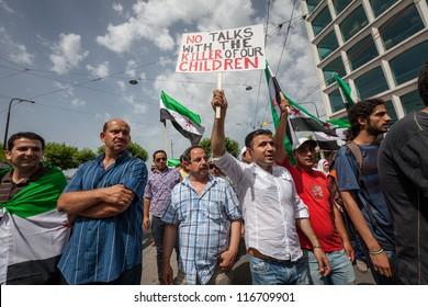 GENEVA, SWITZERLAND - JUNE 30: Unidentified protesters holding signs during a protest against President Bashar al Asaad in the city center of Geneva, June 30, 2012 in Geneva, Switzerland.