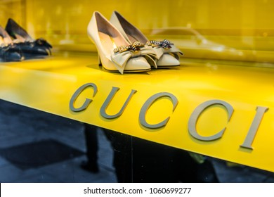 Geneva, Switzerland, March 05, 2018, Gucci window store with fashionable women's high-heeled shoes, sign, logo GUCCI - Italian luxury brand of fashion and leather goods