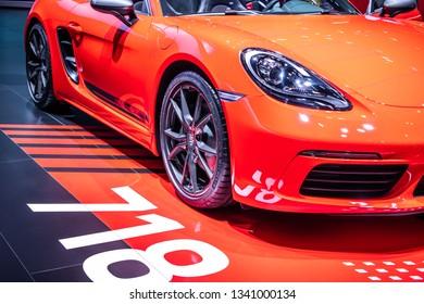 Geneva, Switzerland, March 05, 2019: metallic red Porsche 718 Boxster T at Geneva International Motor Show, cabrio sports car built by Porsche